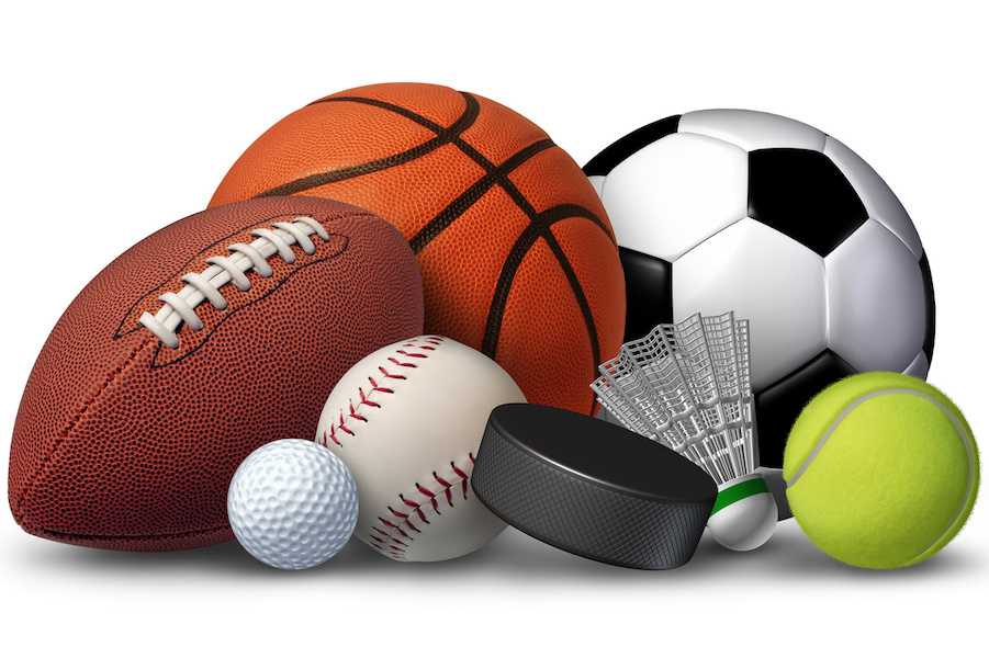 Sports+equipment+with+a+football+basketball+baseball+soccer+tennis+and+golf+ball+and+badminton+hockey+puck+as+recreation+and+leisure+fun+activities+for+team+and+individual+playing.